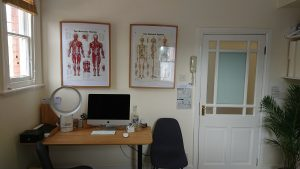 Chiropractic massage room office desk