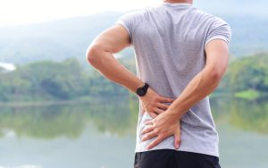 man next to lake low back pain